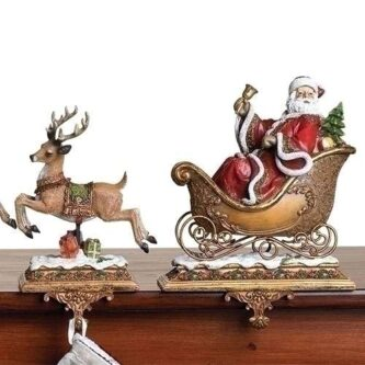 Santa in the sleigh with reindeer stocking holders