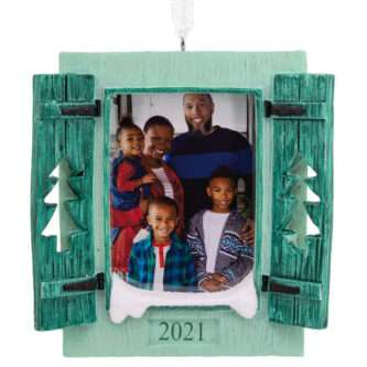 Add your favorite photo to this frame ornament featuring a window framed by pine tree shutters. Dated 2021